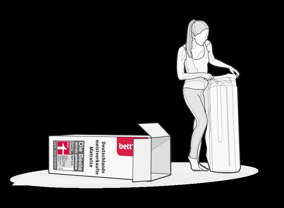 Illustration: Eine Frau hat die komprimierte und gerollte BODYGUARD Matratze aus dem Karton gezogen.